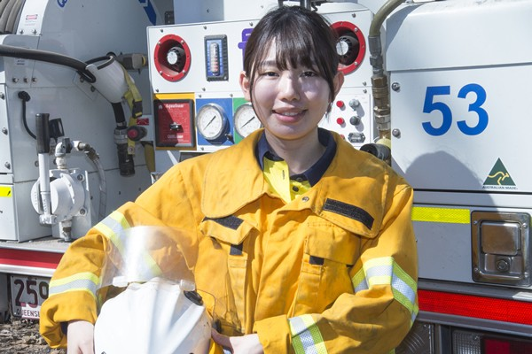Environment consultant Shiori Takemoto, from Japan, gets down to work for Logan City Council in bushland at Greenbank.